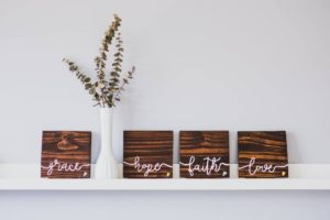 Vase with wooden blocks that say Grace Hope Faith Love