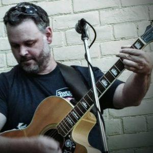 Ken Workman playing guitar