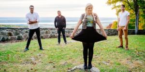 Female and 3 male band members