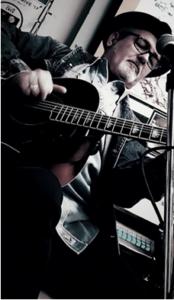 Ray Harris playing guitar