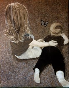 Little girl with baby on the floor