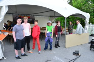 Young volunteers standing at tent
