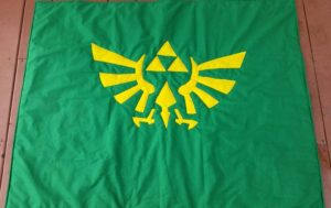Legend of Zelda crest on green quilt