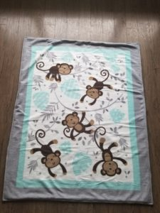 Fleece throw with monkeys