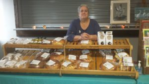 Cheryl Beasley standing behind bread counter