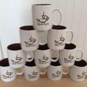 Stacked mugs that say Cup of Jos