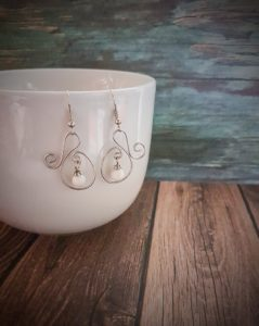 Earrings hanging on cup